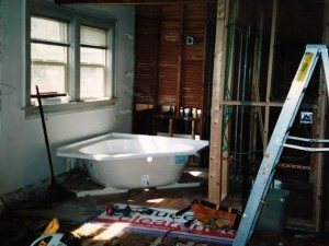 This is the back birth suite tub and bathroom during the remodel.